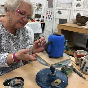 A older woman working on bespoke pottery