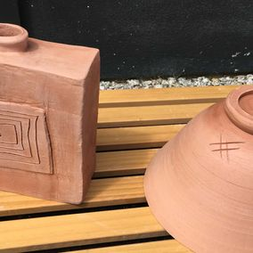 two brown pots that has been styled