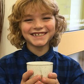 A child with his bespoke pottery
