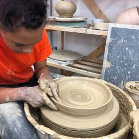 A girl making some bespoke pottery