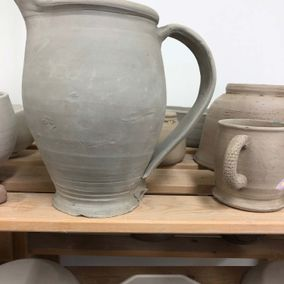 A jug and cups that are ready for decoration