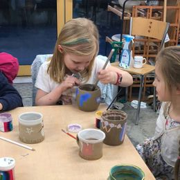 Children decorating pottery